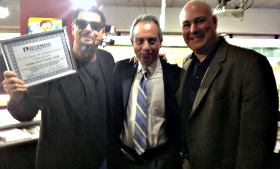 Mancow Holding Fatherhood Excellence Award with FEI Directors James Hagler and Wayne Halick